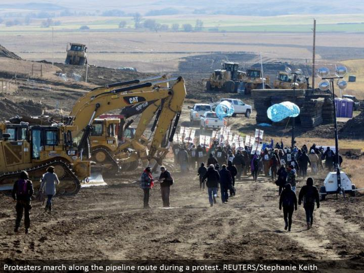 Protesters walk along the pipeline course amid a challenge. REUTERS/Stephanie Keith