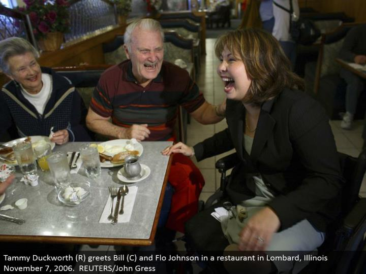 Tammy Duckworth (R) welcomes Bill (C) and Flo Johnson in an eatery in Lombard, Illinois November 7, 2006. REUTERS/John Gress