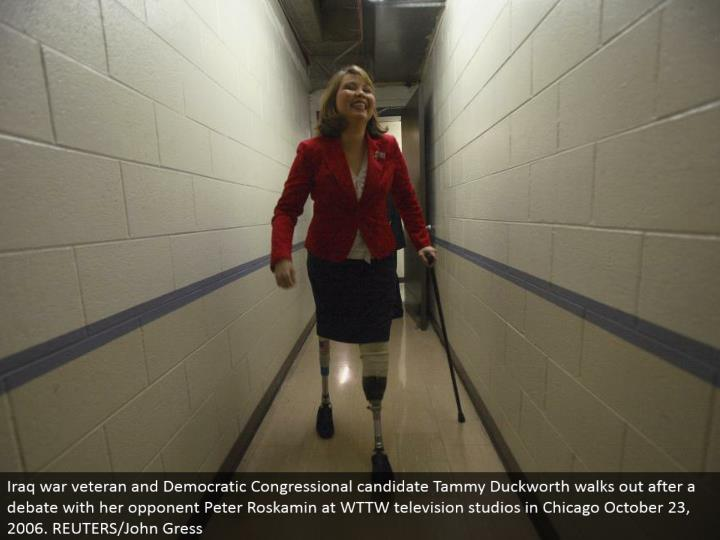 Iraq war veteran and Democratic Congressional applicant Tammy Duckworth exits after an open deliberation with her adversary Peter Roskamin at WTTW TV studios in Chicago October 23, 2006. REUTERS/John Gress