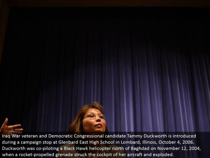 Iraq War veteran and Democratic Congressional hopeful Tammy Duckworth is presented amid a battle stop at Glenbard East High School in Lombard, Illinois, October 4, 2006. Duckworth was co-guiding a Black Hawk helicopter north of Baghdad on November 12, 2004, when a rocket-impelled projectile struck the cockpit of her flying machine and exploded.
