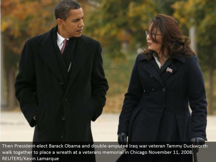 Then President-elect Barack Obama and twofold amputee Iraq war veteran Tammy Duckworth walk together to put a wreath at a veterans commemoration in Chicago November 11, 2008. REUTERS/Kevin Lamarque