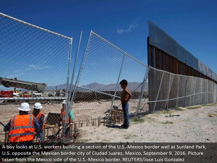 A kid takes a gander at U.S. specialists assembling a segment of the U.S.- Mexico outskirt divider at Sunland Park, U.S. inverse the Mexican fringe city of Ciudad Juarez, Mexico, September 9, 2016. Picture taken from the Mexico side of the U.S.- Mexico outskirt. REUTERS/Jose Luis Gonzalez