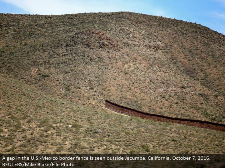 A crevice in the U.S.- Mexico fringe fence is seen outside Jacumba, California, October 7, 2016. REU...
