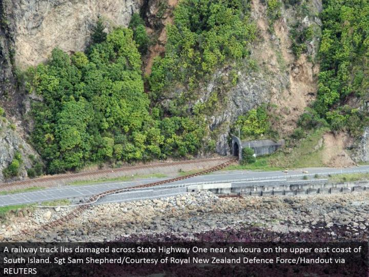 A railroad track lies harmed crosswise over State Highway One close Kaikoura on the upper east shoreline of South Island. Sgt Sam Shepherd/Courtesy of Royal New Zealand Defense Force/Handout by means of REUTERS