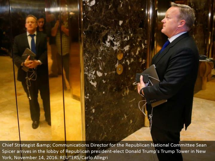 Chief Strategist & Communications Director for the Republican National Committee Sean Spicer touches base in the hall of Republican president-elect Donald's Trump Tower in New York, November 14, 2016. REUTERS/Carlo Allegri