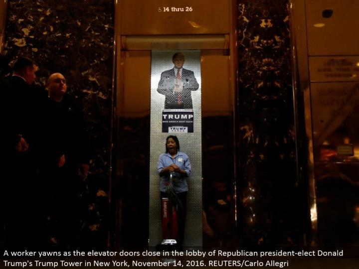 A specialist yawns as the lift entryways shut in the anteroom of Republican president-elect Donald's...