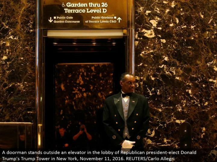 A custodian remains outside a lift in the anteroom of Republican president-elect Donald's Trump Tower in New York, November 11, 2016. REUTERS/Carlo Allegri