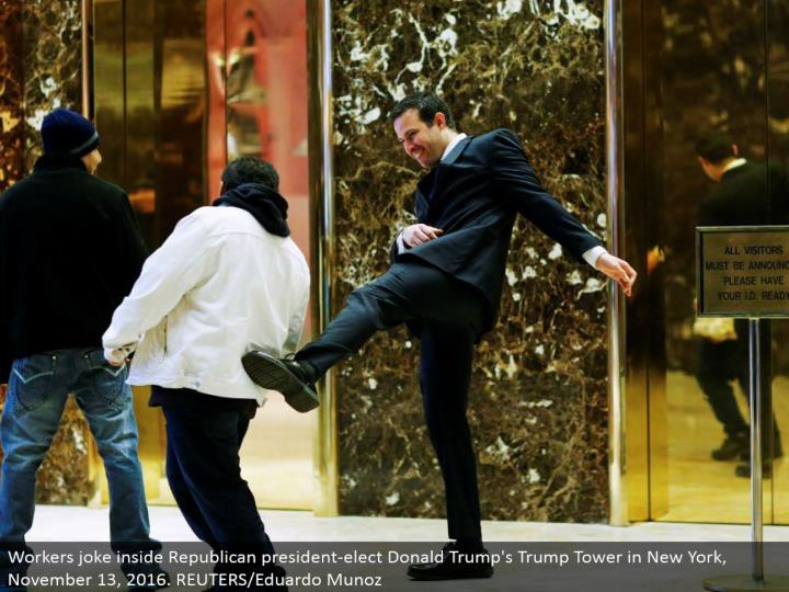 Workers joke inside Republican president-elect Donald's Trump Tower in New York, November 13, 2016. REUTERS/Eduardo Munoz