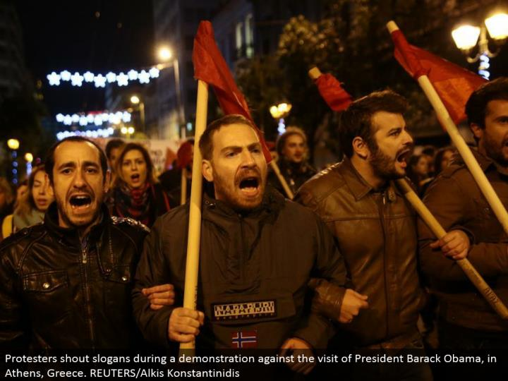 Protesters yell trademarks amid a showing against the visit of President Barack Obama, in Athens, Greece. REUTERS/Alkis Konstantinidis