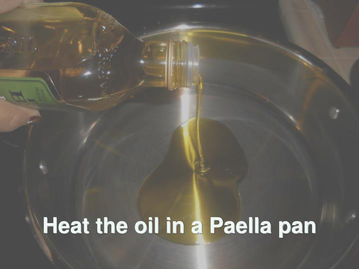Heat the oil in a Paella pan