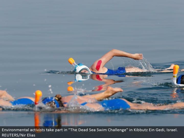 "Environmental activists participate in ""The Dead Sea Swim Challenge"" in Kibbutz Ein Gedi, Israel. REUTERS/Nir Elias"