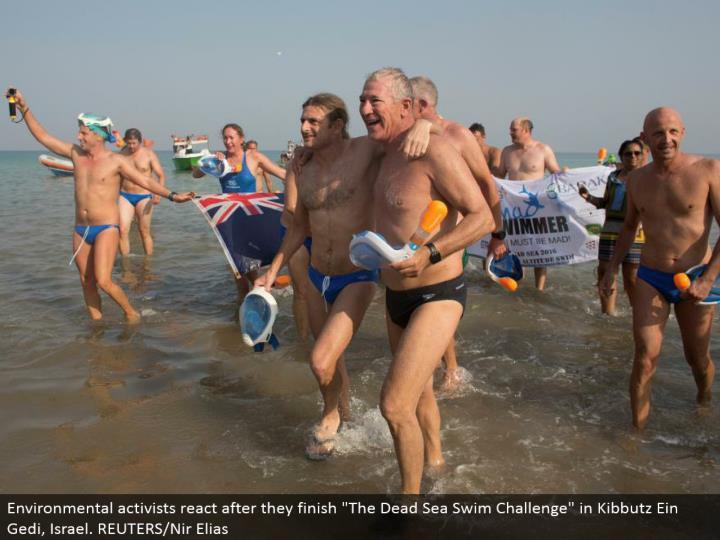 "Environmental activists respond after they complete ""The Dead Sea Swim Challenge"" in Kibbutz Ein Gedi, Israel. REUTERS/Nir Elias"
