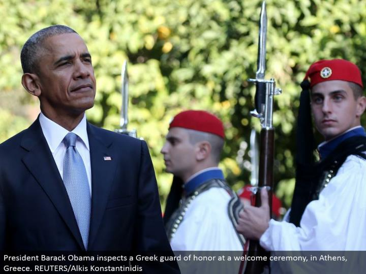 President Barack Obama examines a Greek watch of respect at an appreciated function, in Athens, Greece. REUTERS/Alkis Konstantinidis