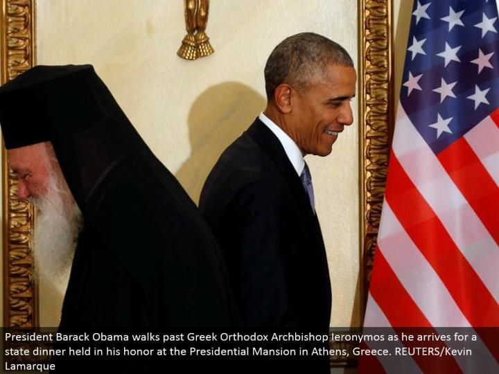 President Barack Obama strolls past Greek Orthodox Archbishop Ieronymos as he touches base for a sta...
