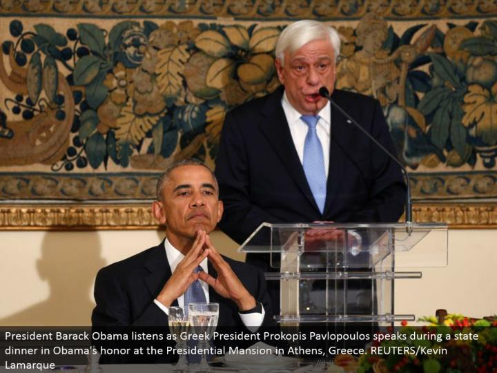 President Barack Obama listens as Greek President Prokopis Pavlopoulos talks amid a state supper in Obama's respect at the Presidential Mansion in Athens, Greece. REUTERS/Kevin Lamarque