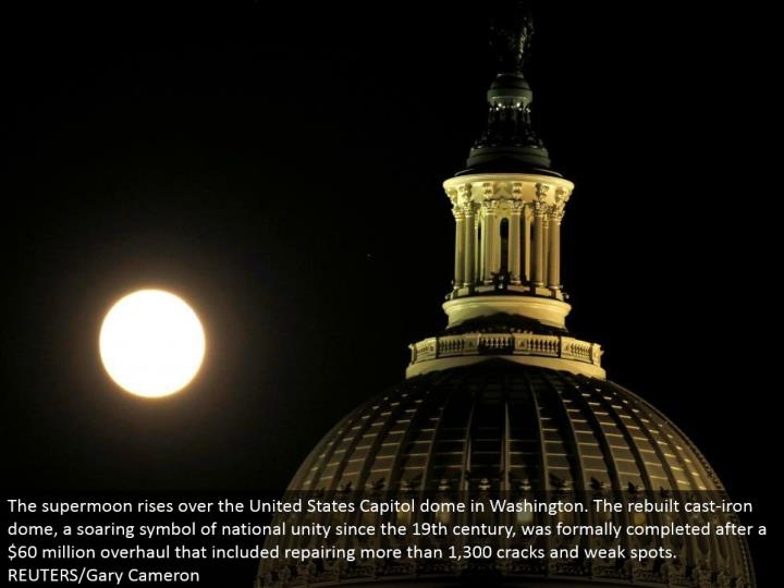 The supermoon ascends over the United States Capitol arch in Washington. The revamped cast-press vault, a taking off image of national solidarity since the nineteenth century, was formally finished after a $60 million upgrade that included repairing more than 1,300 splits and frail spots. REUTERS/Gary Cameron