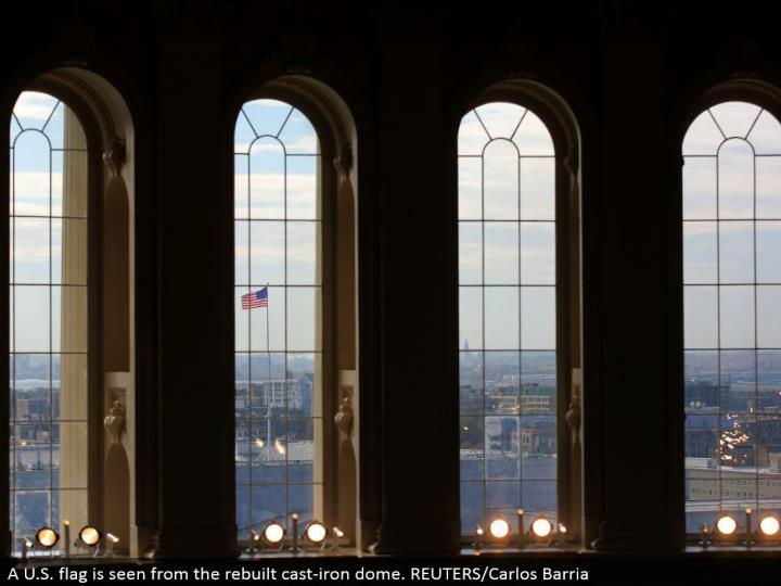 A U.S. banner is seen from the reconstructed cast-press arch. REUTERS/Carlos Barria