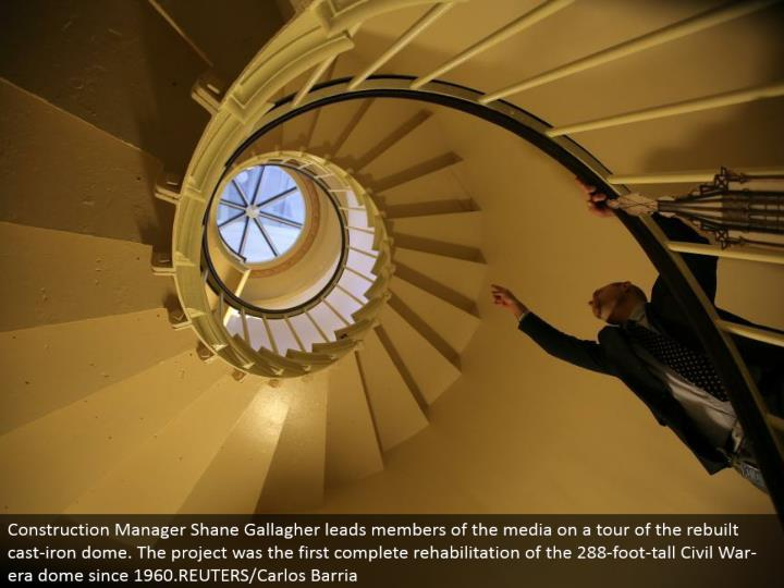 Construction Manager Shane Gallagher drives individuals from the media on a voyage through the modified cast-press vault. The venture was the principal finish recovery of the 288-foot-tall Civil War-period vault since 1960.REUTERS/Carlos Barria