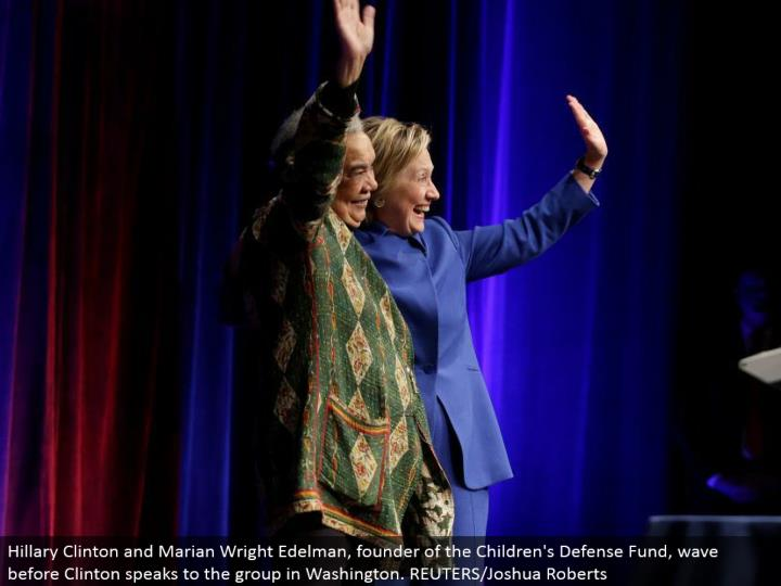 Hillary Clinton and Marian Wright Edelman, author of the Children's Defense Fund, wave before Clinton addresses the gathering in Washington. REUTERS/Joshua Roberts