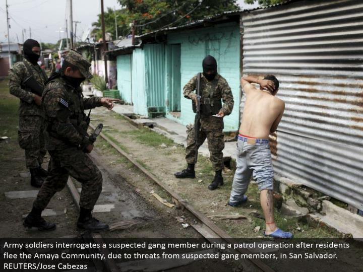 Army troopers questions a speculated group part amid a watch operation after inhabitants escape the Amaya Community, because of dangers from suspected posse individuals, in San Salvador. REUTERS/Jose Cabezas