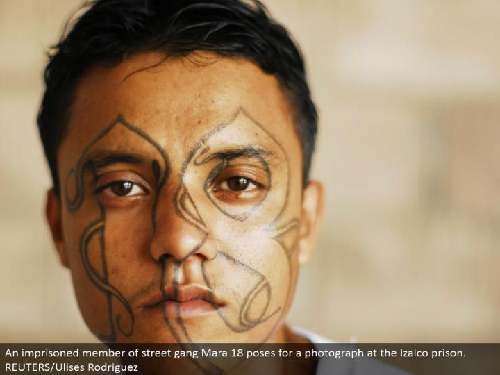 An detained individual from road posse Mara 18 postures for a photo at the Izalco jail. REUTERS/Ulises Rodriguez