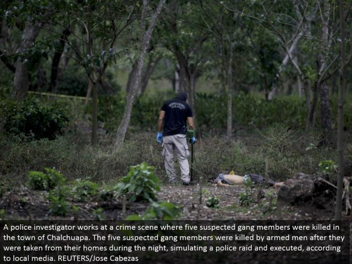 A police agent works at a wrongdoing scene where five presumed pack individuals were executed in the town of Chalchuapa. The five speculated posse individuals were slaughtered by equipped men after they were taken from their homes amid the night, reenacting a police attack and executed, by media. REUTERS/Jose Cabezas