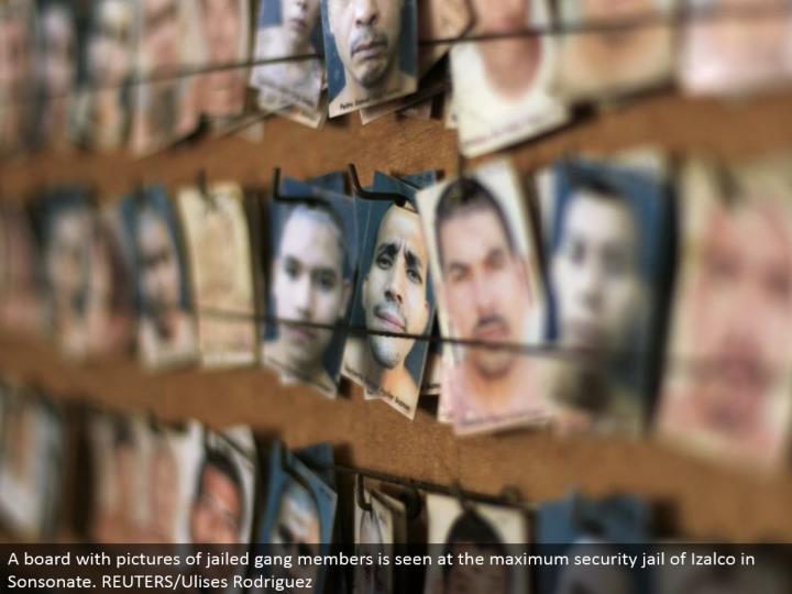 A board with pictures of imprisoned posse individuals is seen at the most extreme security prison of Izalco in Sonsonate. REUTERS/Ulises Rodriguez