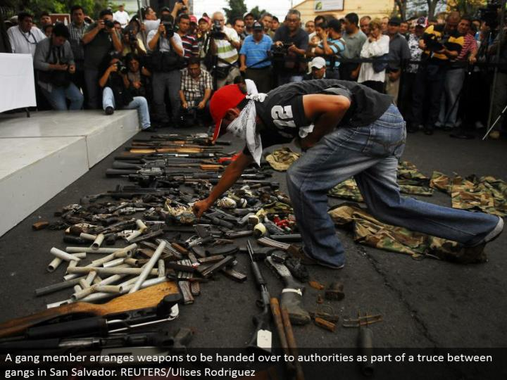 A pack part organizes weapons to be given over to powers as a component of a ceasefire between groups in San Salvador. REUTERS/Ulises Rodriguez