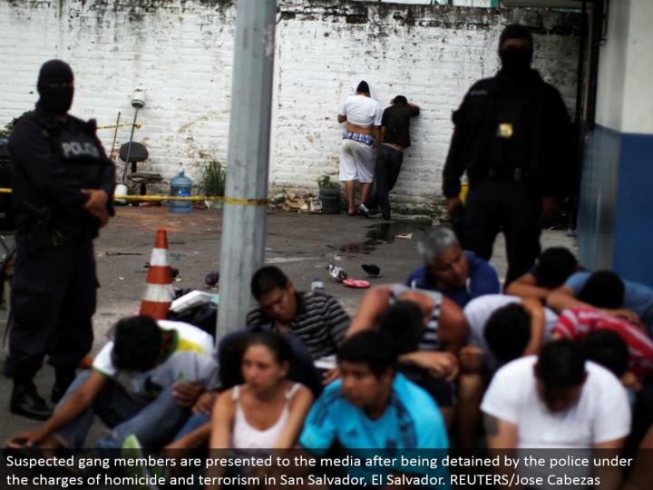Suspected group individuals are displayed to the media subsequent to being kept by the police under the charges of murder and fear mongering in San Salvador, El Salvador. REUTERS/Jose Cabezas