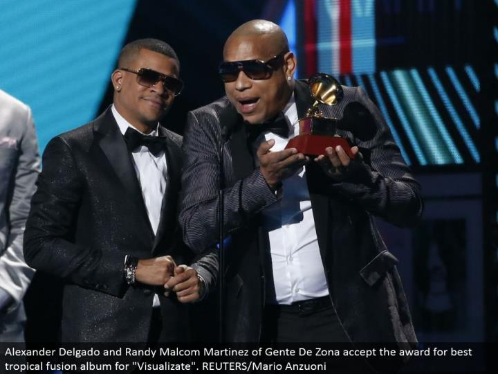 "Alexander Delgado and Randy Malcom Martinez of Gente De Zona acknowledge the honor for best tropical combination collection for ""Visualizate"". REUTERS/Mario Anzuoni"