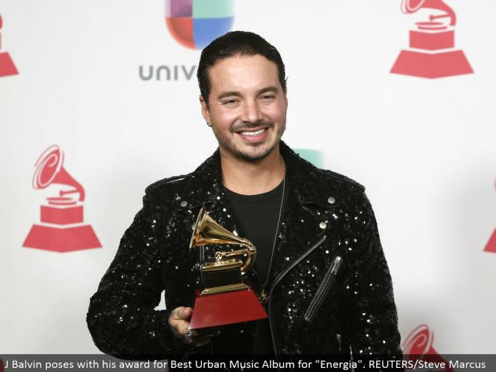 "J Balvin postures with his honor for Best Urban Music Album for ""Energia"". REUTERS/Steve Marcus"