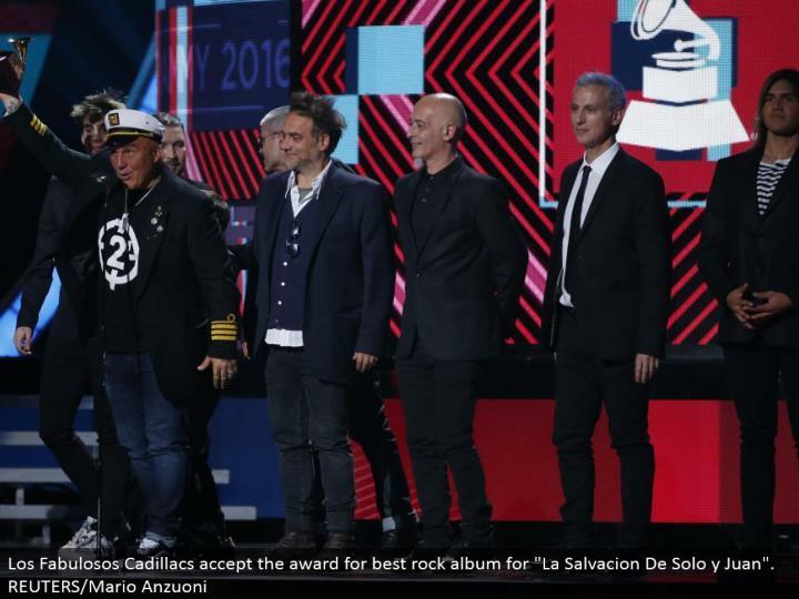 """Los Fabulosos Cadillacs acknowledge the honor for best shake collection for """"La Salvacion De Solo y Juan"""". REUTERS/Mario Anzuoni"""
