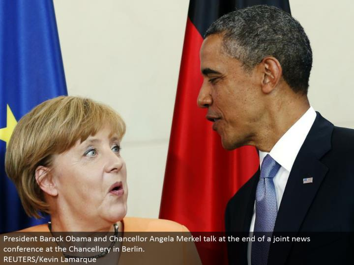 President Barack Obama and Chancellor Angela Merkel talk toward the end of a joint news meeting at the Chancellery in Berlin. REUTERS/Kevin Lamarque