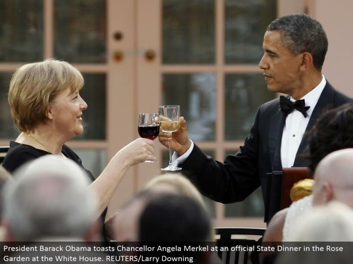 President Barack Obama toasts Chancellor Angela Merkel at an official State Dinner in the Rose Garden at the White House. REUTERS/Larry Downing