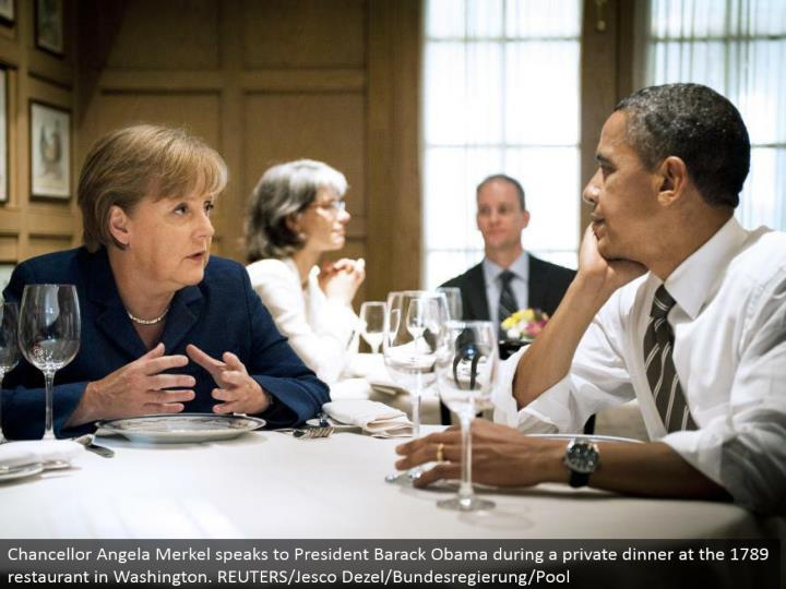 Chancellor Angela Merkel addresses President Barack Obama amid a private supper at the 1789 eatery in Washington. REUTERS/Jesco Dezel/Bundesregierung/Pool