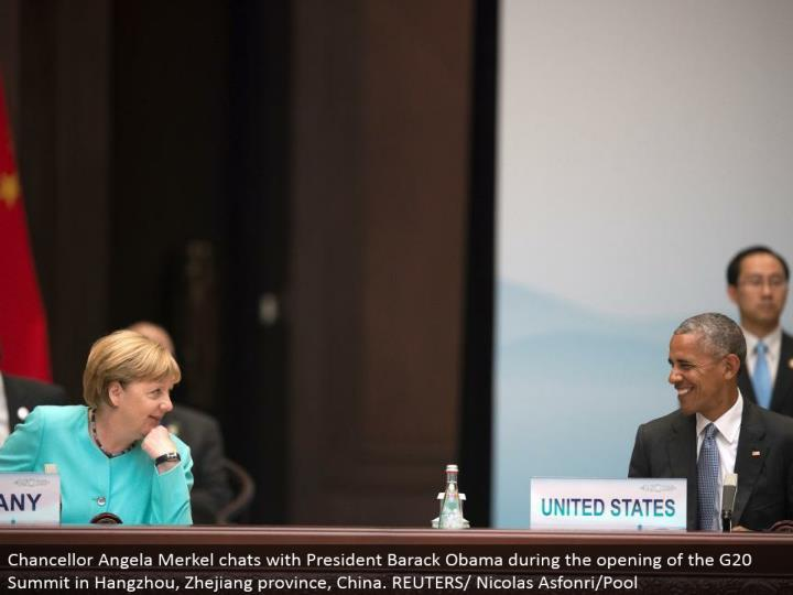 Chancellor Angela Merkel visits with President Barack Obama amid the opening of the G20 Summit in Hangzhou, Zhejiang territory, China. REUTERS/Nicolas Asfonri/Pool