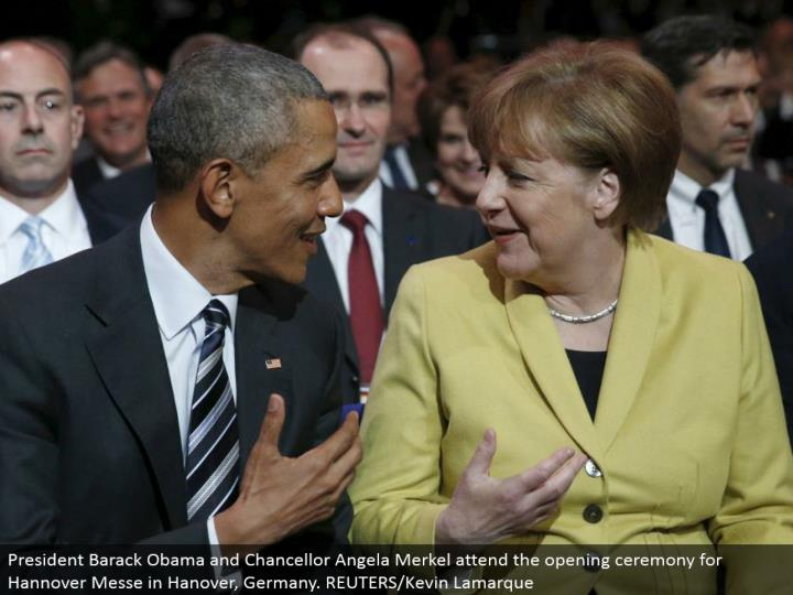 President Barack Obama and Chancellor Angela Merkel go to the opening service for Hannover Messe in Hanover, Germany. REUTERS/Kevin Lamarque