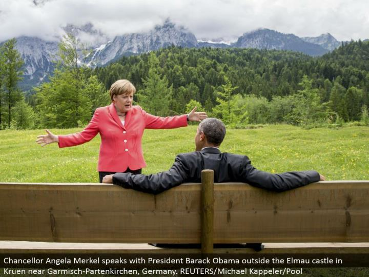 Chancellor Angela Merkel talks with President Barack Obama outside the Elmau manor in Kruen close Garmisch-Partenkirchen, Germany. REUTERS/Michael Kappeler/Pool