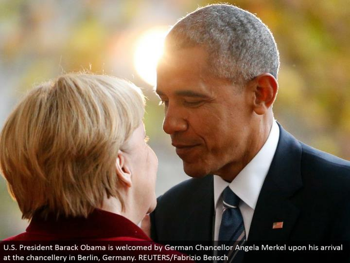 U.S. President Barack Obama is invited by German Chancellor Angela Merkel upon his landing in the chancellery in Berlin, Germany. REUTERS/Fabrizio Bensch