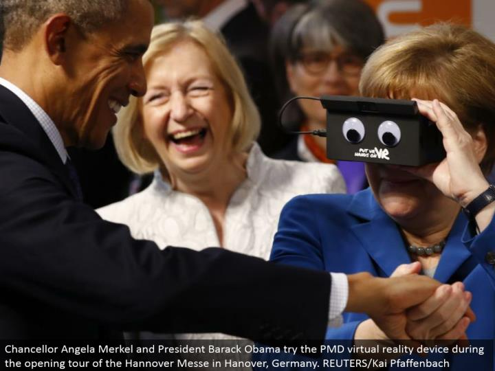 Chancellor Angela Merkel and President Barack Obama attempt the PMD virtual reality gadget amid the opening voyage through the Hannover Messe in Hanover, Germany. REUTERS/Kai Pfaffenbach