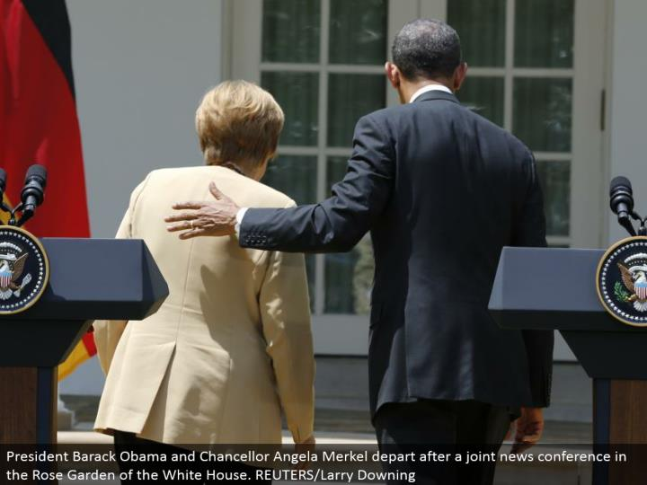 President Barack Obama and Chancellor Angela Merkel withdraw after a joint news meeting in the Rose Garden of the White House. REUTERS/Larry Downing