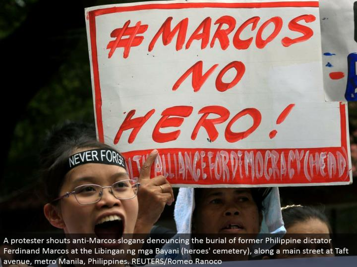 A nonconformist yells against Marcos mottos reprimanding the entombment of previous Philippine tyrant Ferdinand Marcos at the Libingan ng mga Bayani (legends' graveyard), along a principle road at Taft road, metro Manila, Philippines. REUTERS/Romeo Ranoco