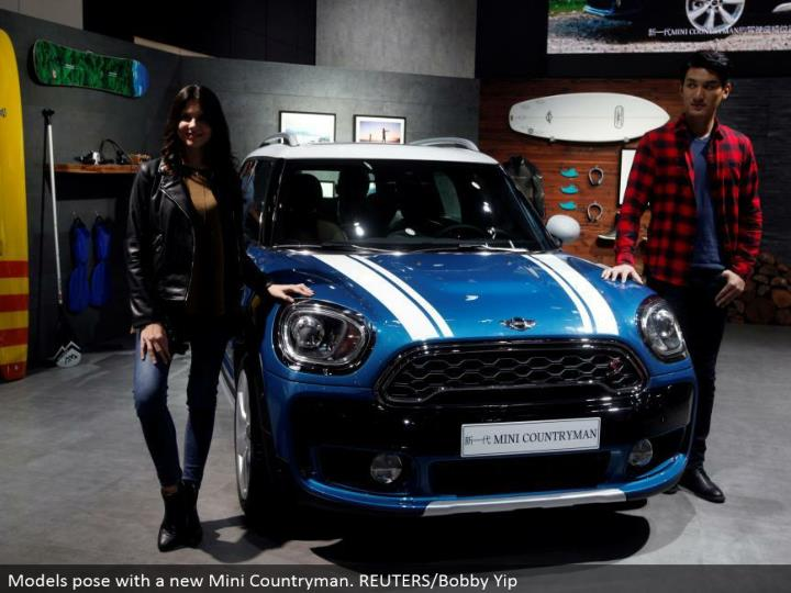 Models posture with another Mini Countryman. REUTERS/Bobby Yip