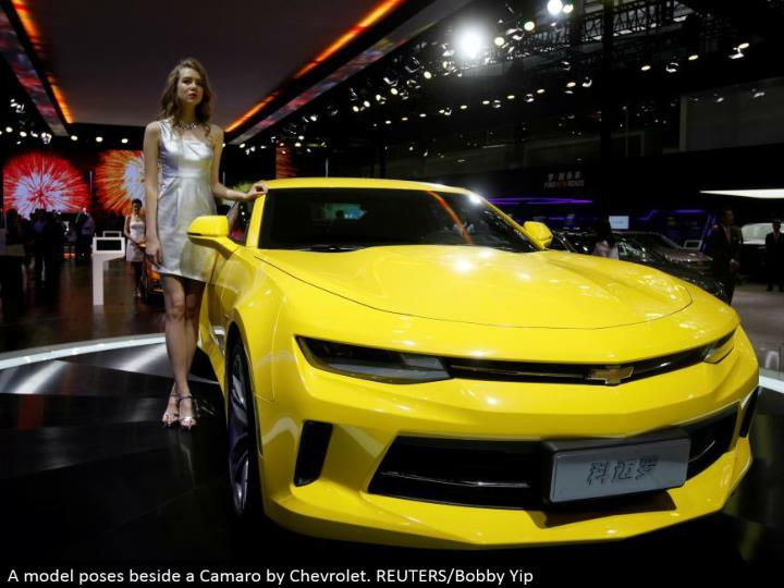 A demonstrate postures next to a Camaro by Chevrolet. REUTERS/Bobby Yip