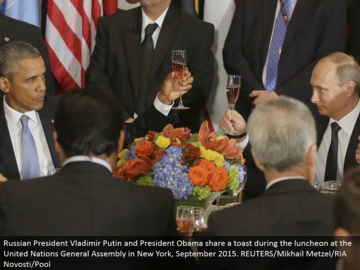 Russian President Vladimir Putin and President Obama share a toast amid the lunch meeting at the United Nations General Assembly in New York, September 2015. REUTERS/Mikhail Metzel/RIA Novosti/Pool