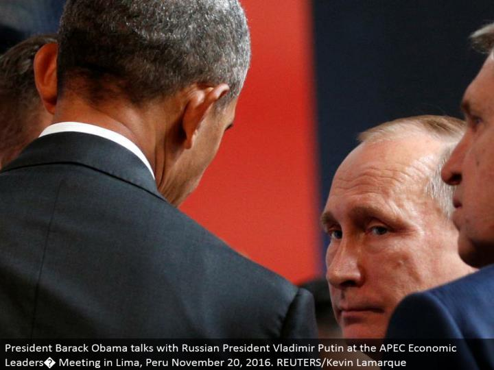 President Barack Obama chats with Russian President Vladimir Putin at the APEC Economic Leaders� M...