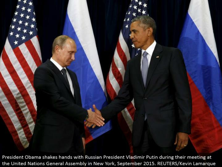 President Obama shakes hands with Russian President Vladimir Putin amid their meeting at the United Nations General Assembly in New York, September 2015. REUTERS/Kevin Lamarque