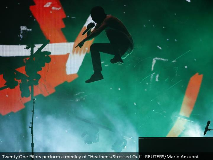 "Twenty One Pilots play out a grouping of ""Savages/Stressed Out"". REUTERS/Mario Anzuoni"