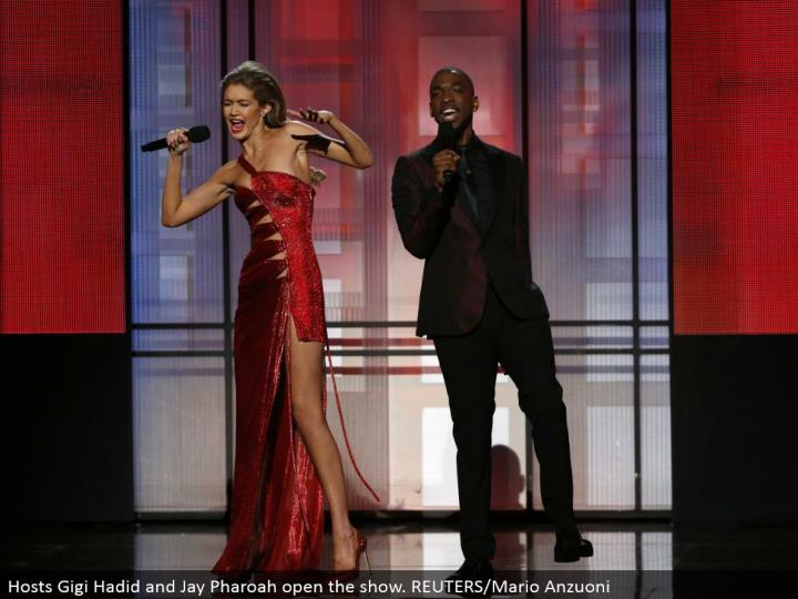 Hosts Gigi Hadid and Jay Pharoah open the show. REUTERS/Mario Anzuoni