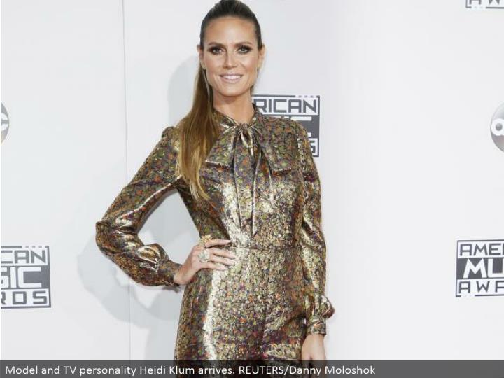 Model and TV character Heidi Klum arrives. REUTERS/Danny Moloshok